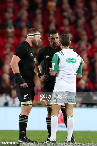 Referee Romain Poite gives Jerome Kaino of the All Blacks a yellow card with captain Kieran Read discussing during the Test match between the New...