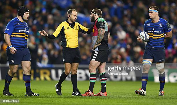 Referee Romain Poite of France rules out a try scored by Mike Brown as Joe Marler the captain of Harlequins listens during the European Rugby...
