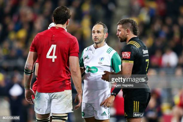 Referee Romain Poite of France talks to Iain Henderson of the Lions before showing his a yellow card during the match between the Hurricanes and the...