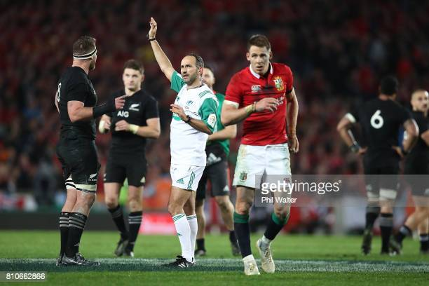 Referee Romain Poite speaks with All Black captain Kieran Read as he downgrades a call made in the final minutes from a penalty to a scrum during the...