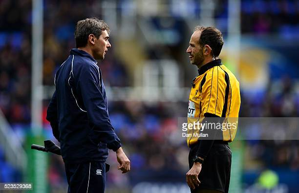Referee Romain Poite speaks with Assistant Referee Jerome Garces during the European Rugby Champions Cup Semi Final between Saracens and Wasps at the...