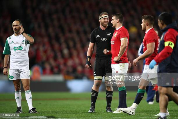 Referee Romain Poite stands next to All Black captain Kieran Read and Lions captain Sam Warburton as he downgrades a call made in the final minutes...