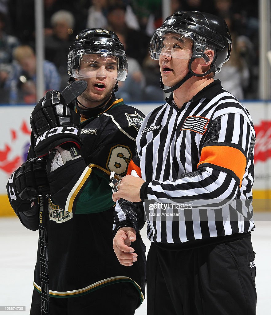 Referee Ryan Park #10 chats with Ryan Rupert #64 of the London Knights in an OHL game against the Sarnia Sting on January 1, 2013 at the Budweiser Gardens in London, Canada. The Sting defeated the Knights 6-5 in overtime to snap London's 24 game winning streak.