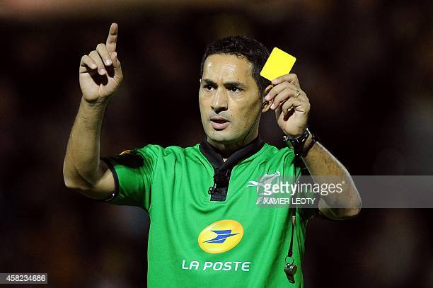 Referee Salem Attalah shows a yellow card during the French Top 14 rugby union match between La Rochelle and Montpellier at the Marcel Deflandre...