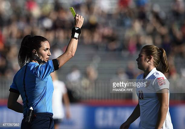 Referee Salome Di Iorio gives a yellow card to Norway's midfielder Anja Sonstevold during a Group B football match at the 2015 FIFA Women's World Cup...