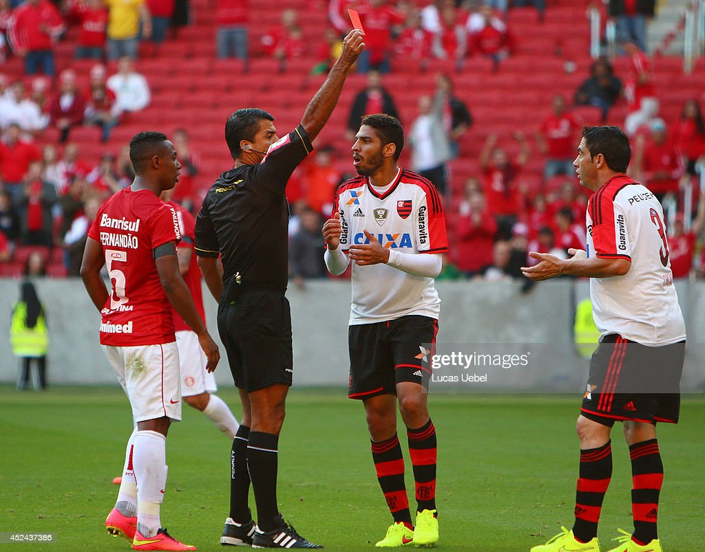 Referee Sandro Meira Ricci show the red card to Chicao of Flamengo during match between Internacional and Flamengo as part of Brasileirao Series A 2014, at Estadio Beira-Rio on July 20, 2014 in Porto Alegre, Brazil.