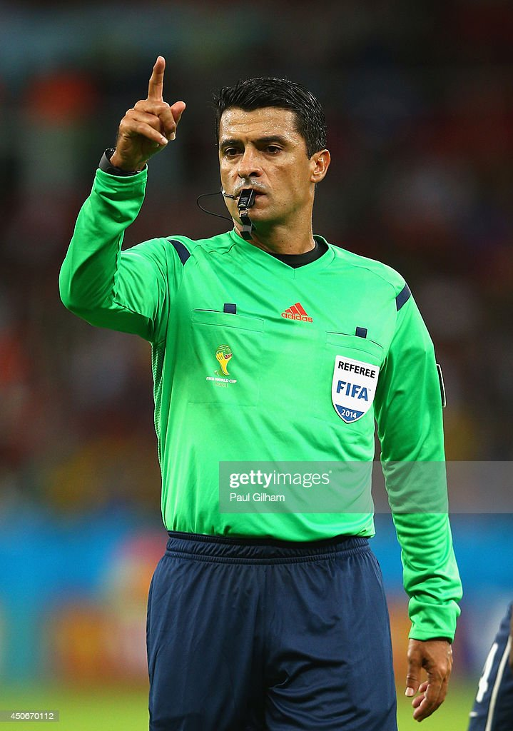 Referee <a gi-track='captionPersonalityLinkClicked' href=/galleries/search?phrase=Sandro+Ricci&family=editorial&specificpeople=9145717 ng-click='$event.stopPropagation()'>Sandro Ricci</a> gestures during the 2014 FIFA World Cup Brazil Group E match between France and Honduras at Estadio Beira-Rio on June 15, 2014 in Porto Alegre, Brazil.