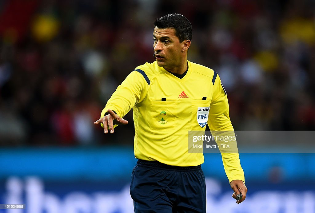 Referee <a gi-track='captionPersonalityLinkClicked' href=/galleries/search?phrase=Sandro+Ricci&family=editorial&specificpeople=9145717 ng-click='$event.stopPropagation()'>Sandro Ricci</a> gestures during the 2014 FIFA World Cup Brazil Round of 16 match between Germany and Algeria at Estadio Beira-Rio on June 30, 2014 in Porto Alegre, Brazil.