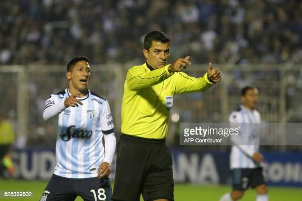 Referee Sandro Ricci gestures during the Atletico Tucuman vs Oriente Petrolero Copa Sudamericana 2017 football match at the Jose Fierro stadium in...