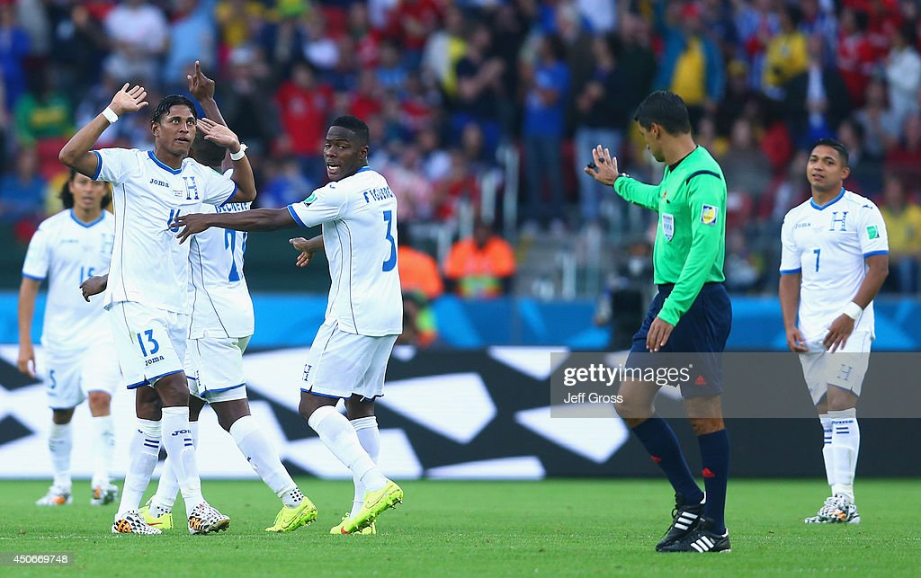 Referee <a gi-track='captionPersonalityLinkClicked' href=/galleries/search?phrase=Sandro+Ricci&family=editorial&specificpeople=9145717 ng-click='$event.stopPropagation()'>Sandro Ricci</a> gestures toward the Honduras team as they react after France's second goal during the 2014 FIFA World Cup Brazil Group E match between France and Honduras at Estadio Beira-Rio on June 15, 2014 in Porto Alegre, Brazil.
