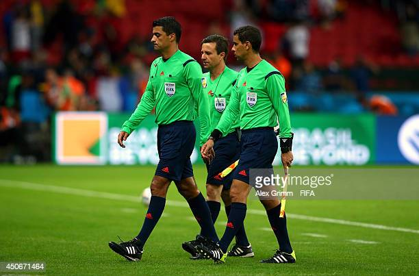 Referee Sandro Ricci leaves the pitch with match officials after the 2014 FIFA World Cup Brazil Group E match between France and Honduras at Estadio...