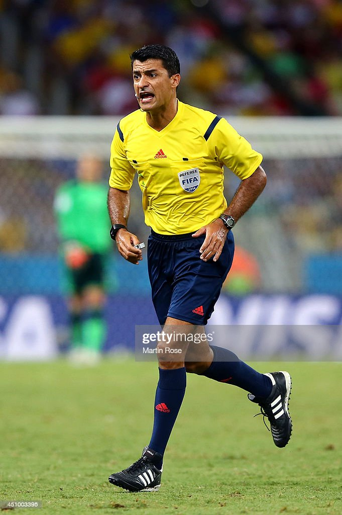 Referee <a gi-track='captionPersonalityLinkClicked' href=/galleries/search?phrase=Sandro+Ricci&family=editorial&specificpeople=9145717 ng-click='$event.stopPropagation()'>Sandro Ricci</a> reacts during the 2014 FIFA World Cup Brazil Group G match between Germany and Ghana at Castelao on June 21, 2014 in Fortaleza, Brazil.