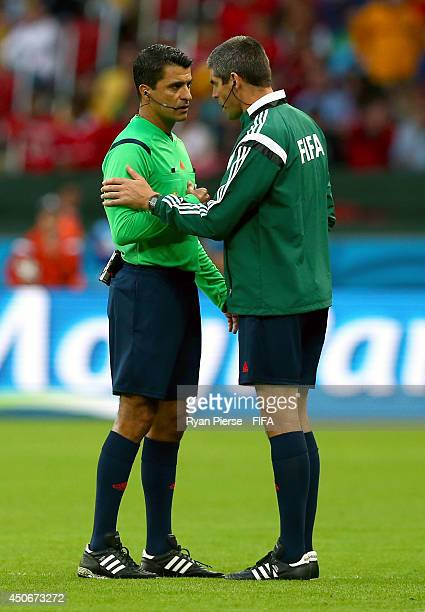 Referee Sandro Ricci speaks with an official during the 2014 FIFA World Cup Brazil Group E match between France and Honduras at Estadio BeiraRio on...