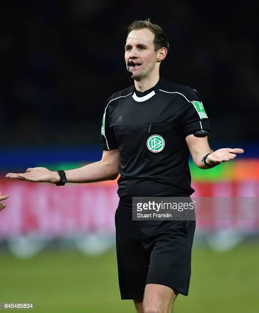 Referee Sascha Stegemann gestures during the Bundesliga match between Hertha BSC and Eintracht Frankfurt at Olympiastadion on February 25 2017 in...