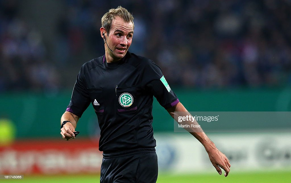 Referee Sascha Stegemann looks on during the DFB Cup second round match between Hamburger SV and Greuther Fuerth at Imtech Arena on September 24, 2013 in Hamburg, Germany.