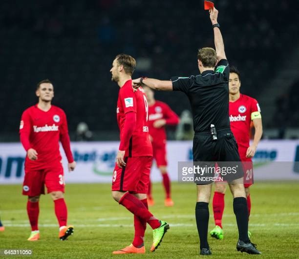 Referee Sascha Stegemann shows Frankfurt's Swiss forward Haris Seferovic the red card during the German first division Bundesliga football match...