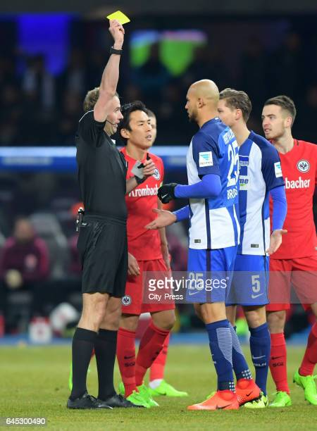 referee Sascha Stegemann shows John Anthony Brooks of Hertha BSC the yellow card during the game between Hertha BSC and the Eintracht Frankfurt on...