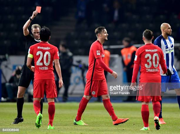 Referee Sascha Stegemann shows the red card to Haris Seferovic of Frankfurt during the Bundesliga match between Hertha BSC and Eintracht Frankfurt at...