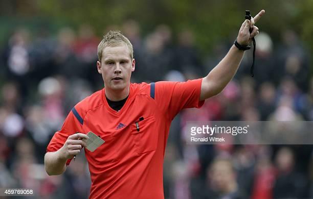 Referee Sascha Weirich reacts during the Regionalliga West match between 1 FC Koeln II and RotWeiss Essen at FranzKremerStadion on November 29 2014...