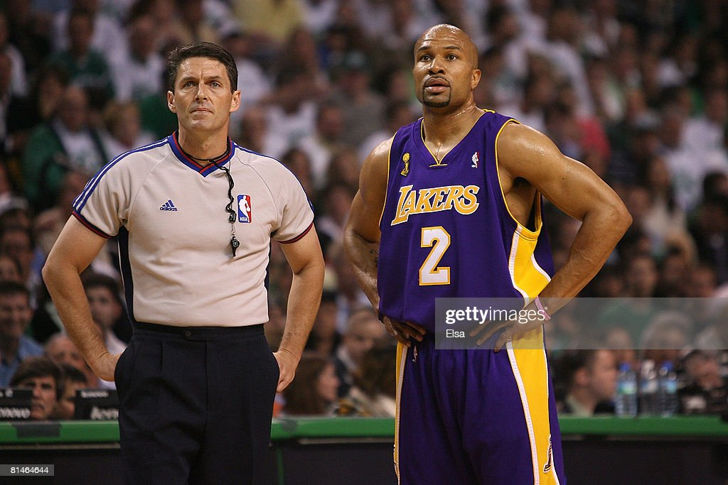 Referee Scott Foster stands next to Derek Fisher of the Los Angeles Lakers in Game One of the 2008 NBA Finals on June 5 2008 against the Boston...