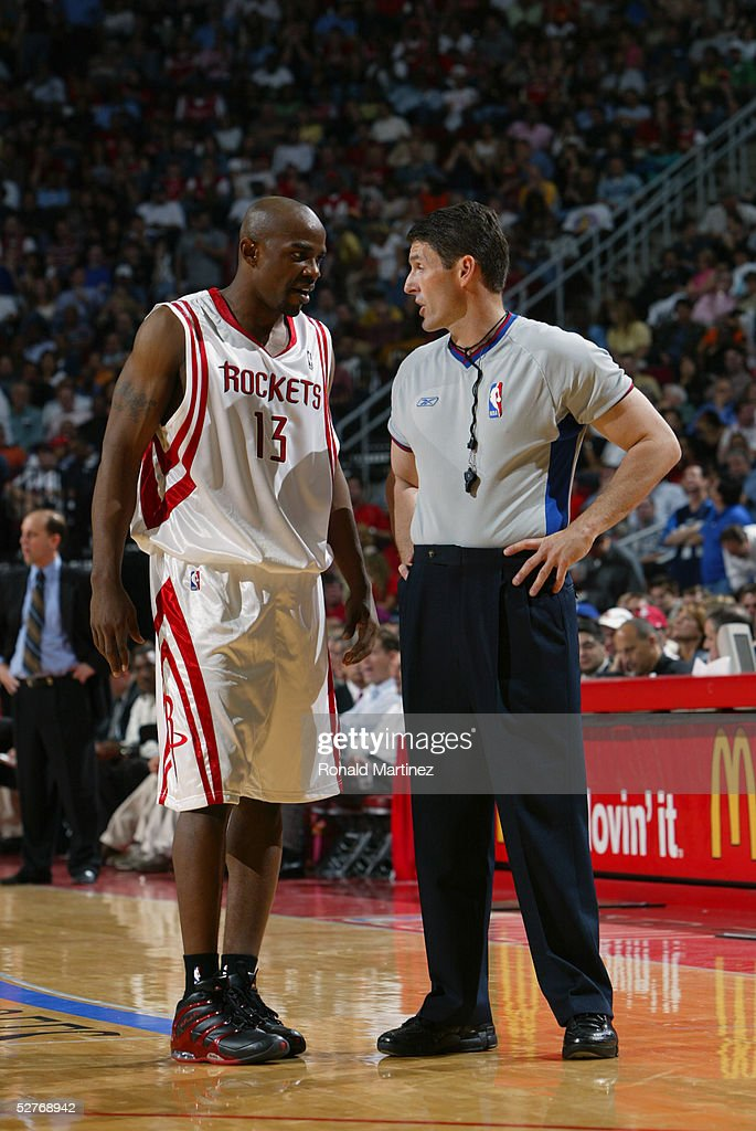 Referee Scott Foster talks to Mike James of the Houston Rockets in Game three of the Western Conference Quarterfinals against the Dallas Mavericks...
