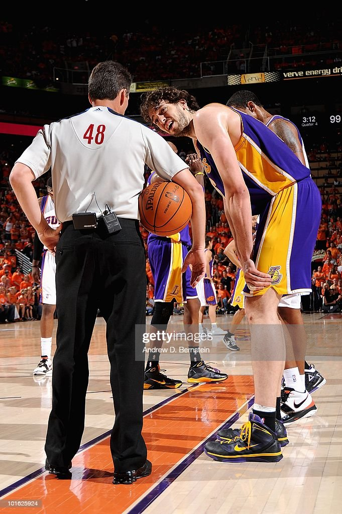 Referee Scott Foster talks to Pau Gasol of the Los Angeles Lakers in Game Six of the Western Conference Finals against the Phoenix Suns on May 29...