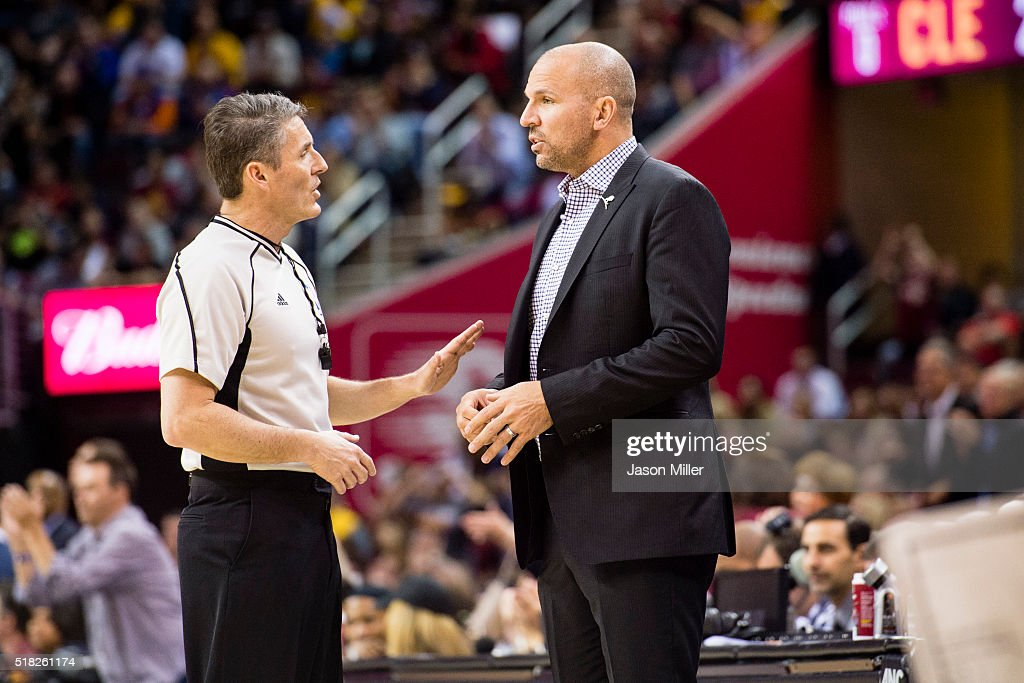 Referee Scott Foster talks with head coach Jason Kidd of the Milwaukee Bucks during the first half against the Cleveland Cavaliers at Quicken Loans...