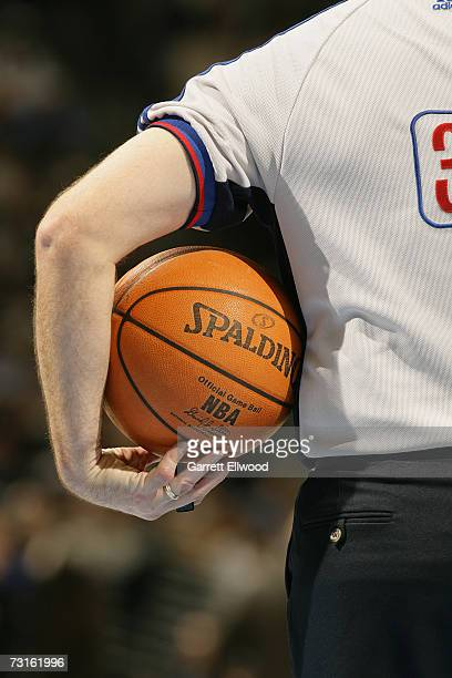 Referee Scott Wall holds the official NBA leather basketball which replaced the previous microfibre synthetic ball on new year's day during the NBA...