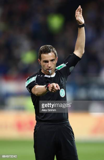 Referee Sebastian Brand reacts during the Bundesliga match between SV Darmstadt 98 and Bayer 04 Leverkusen at Jonathan Heimes Stadion am...