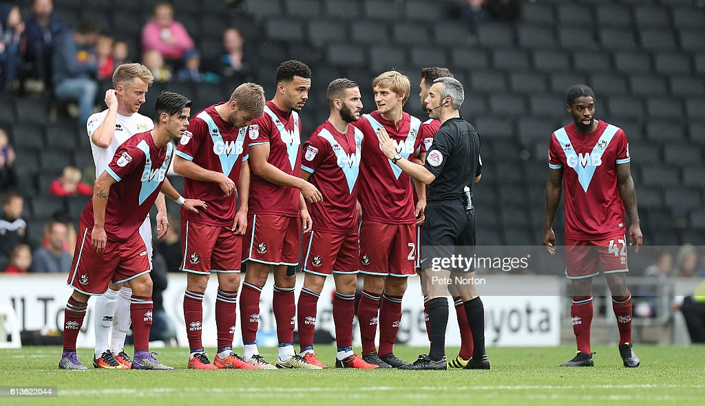 Referee Sebastian Stockbridge talks to Port Vale players as they line up to defend a free kick during the Sky Bet League One match between Milton Keynes Dons and Port Vale at StadiumMK on October 9, 2016 in Milton Keynes, England.