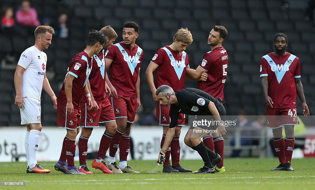 Referee Sebastian Stockbridge uses vanishing spray as Port Vale players line up to defend a free kick during the Sky Bet League One match between Milton Keynes Dons and Port Vale at StadiumMK on October 9, 2016 in Milton Keynes, England.