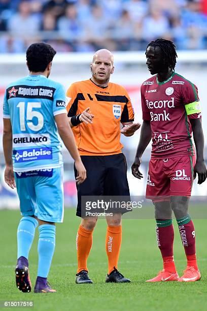 Referee Sebastien Delferiere corrects Kenneth Saief midfielder of KAA Gent and Mbaye Leye forward of SV Zulte Waregem during the Jupiler Pro League...