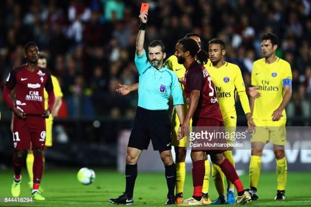 Referee Sebastien Desiage shows Benoit AssouEkotto of Metz FC a red card during the Ligue 1 match between Metz and Paris Saint Germain or PSG held at...