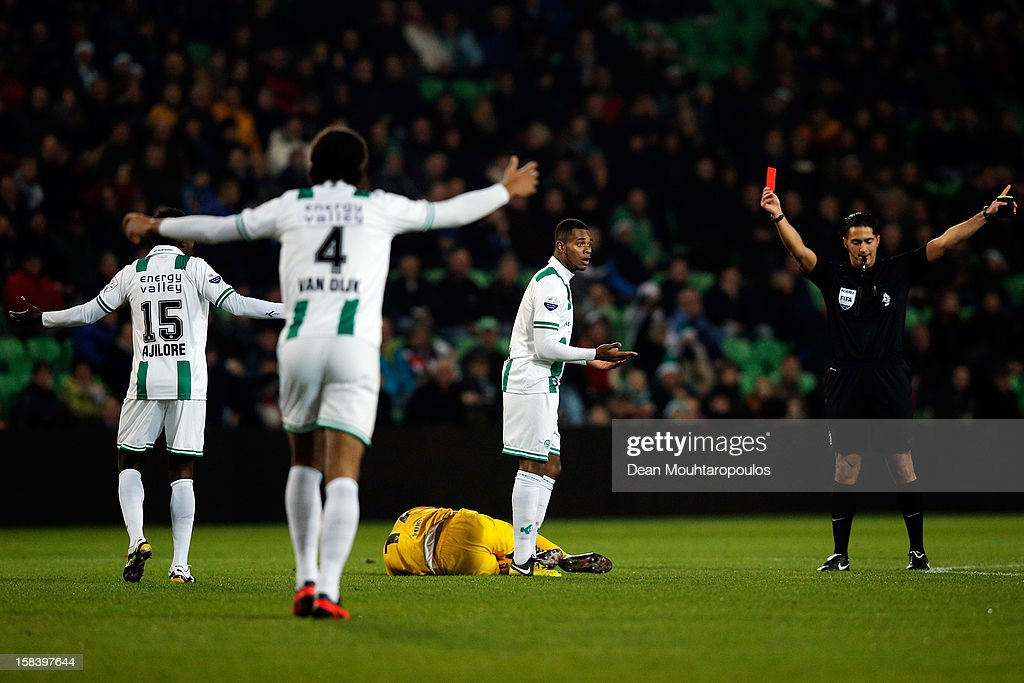 Referee, Serdar Gozubuyuk shows a red card to Leandro Bacuna of Groningen during the Eredivisie match between FC Groningen and VVV Venlo at the Euroborg Stadium on December 15, 2012 in Groningen, Netherlands.