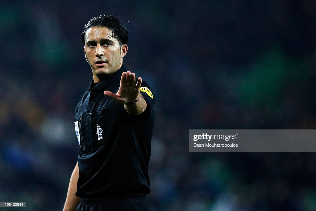 Referee, Serdar Gozubuyuk signals to a player during the Eredivisie match between FC Groningen and VVV Venlo at the Euroborg Stadium on December 15, 2012 in Groningen, Netherlands.