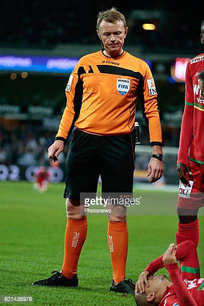 referee Serge Gumienny and Yasssine El Ghanassy midfielder of KV Oostende pictured during the Jupiler Pro League match between RSC Anderlecht and KV...