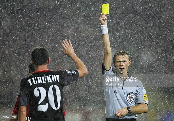 Referee Serge Gumienny of Belgium shows a yellow card to Yordan Yurukov of Sofia during the UEFA Cup match between Bayer Leverkusen and CSKA Sofia at...