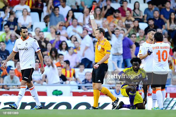 Referee Serge Gumienny shows a red card to Adil Rami of Valencia CF for a challenge on Wilfried Bony of Swansea City the UEFA Europa League Group A...