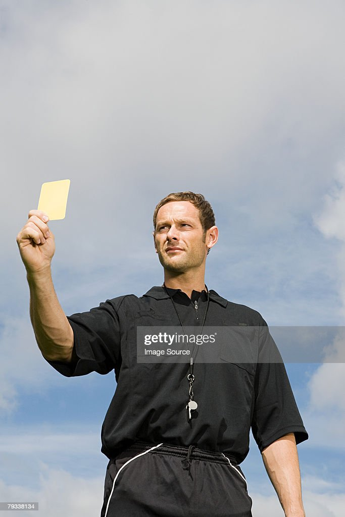 A referee showing a yellow card : Stock Photo