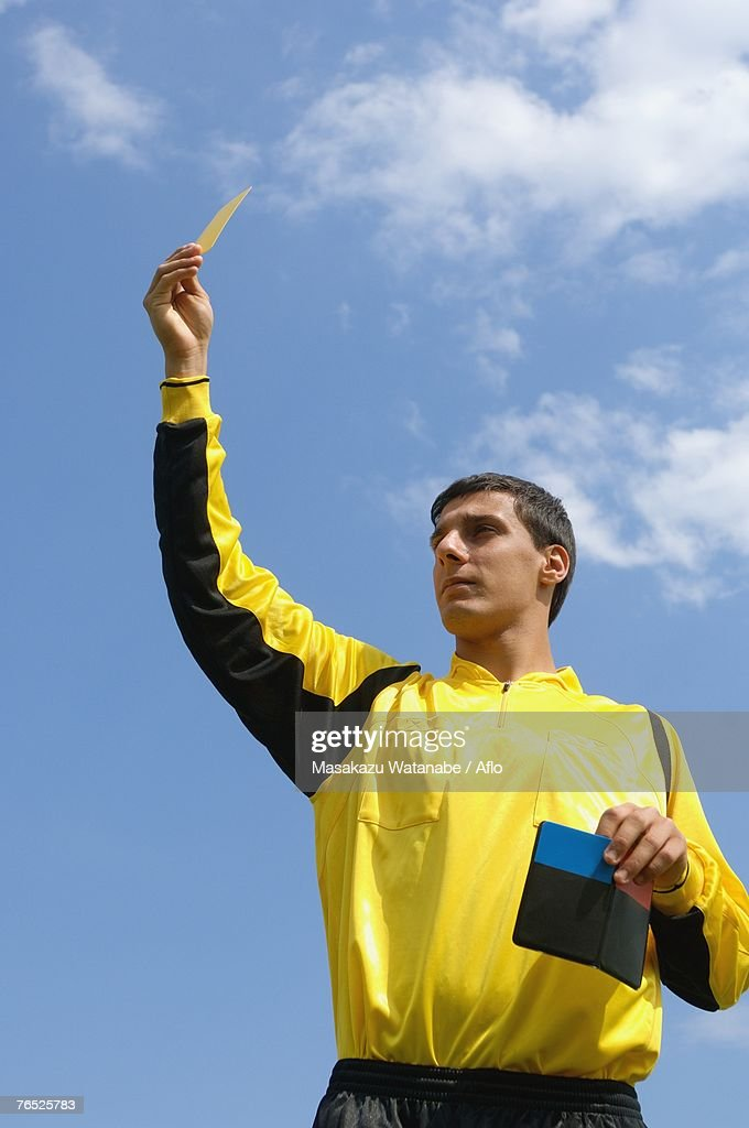 Referee showing yellow card : Stock Photo