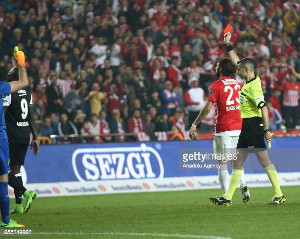 Referee shows a red card to Aboubakar of Besiktas during the Turkish Spor Toto Super Lig football match between Antalyaspor and Besiktas at the...