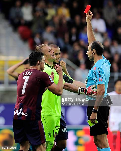 Referee shows a red card to Eibar's goalkeeper Yoel Rodriguez during the Spanish league football match SD Eibar vs Sevilla FC at the Ipurua stadium...