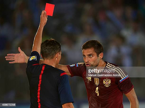 Referee shows Aleksey Makarov of Russia a red card during day five of the Beach Soccer Intercontinental Cup 2014 final match between Brazil and...
