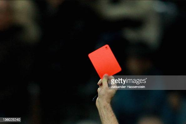 Referee shows the Red card during the Bundesliga match between FC Bayern Muenchen and 1 FC Koeln at Allianz Arena on December 16 2011 in Munich...