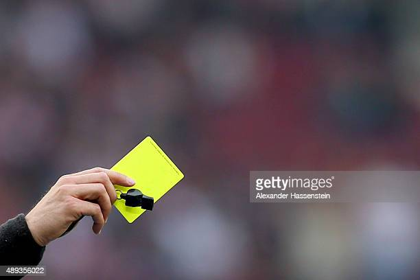 Referee shows the Yellow Card during the Bundesliga match between VfB Stuttgart and FC Schalke 04 at MercedesBenz Arena on September 20 2015 in...