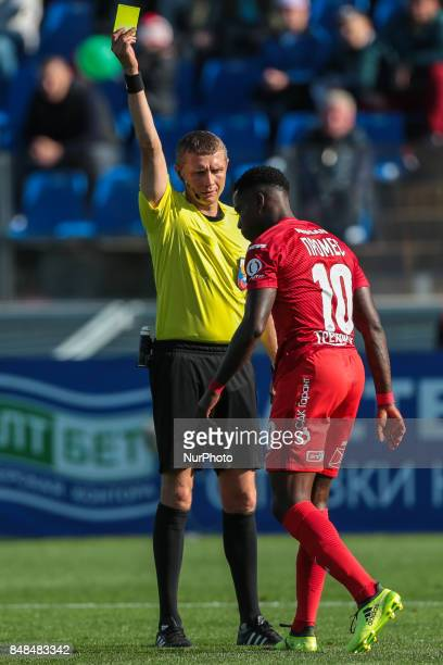 Referee shows the yellow cards to Quincy Promes during the Russian Football League match between FC Tosno and FC Spartak Moscow at Petrovsky Stadium...