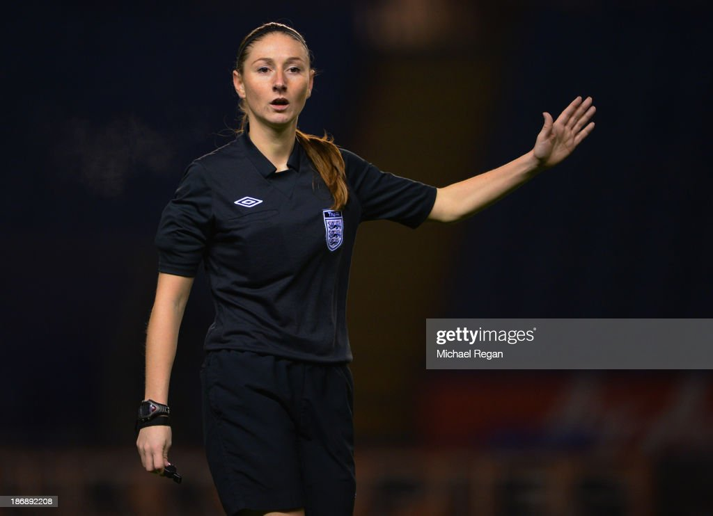 Referee <a gi-track='captionPersonalityLinkClicked' href=/galleries/search?phrase=Sian+Massey&family=editorial&specificpeople=6733765 ng-click='$event.stopPropagation()'>Sian Massey</a> gestures during the Barclays U21 Premier League match between Leicester City U21 and Blackburn Rovers U21 at The King Power Stadium on November 4, 2013 in Leicester, England.