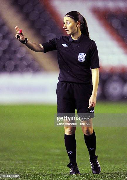 Referee Sian Massey gestures during the FA WSL Continental Cup match between Liverpool Ladies FC and Everton Ladies FC at the Halton Stadium on March...