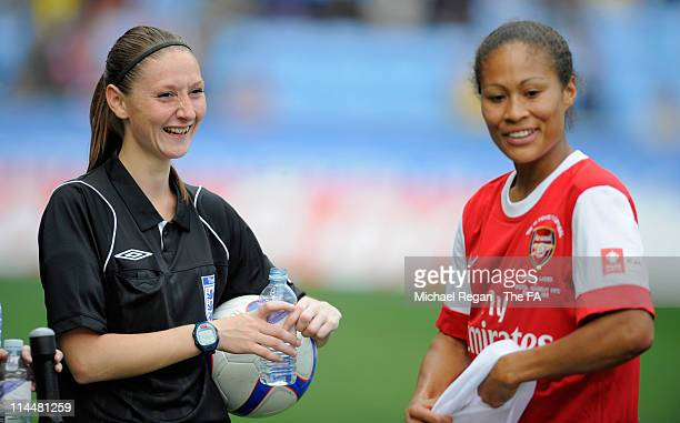 Referee Sian Massey jokes with Rachel Yankey of Arsenal during the Women's FA Cup Final between Arsenal LFC and Bristol Academy WFC at the Ricoh...
