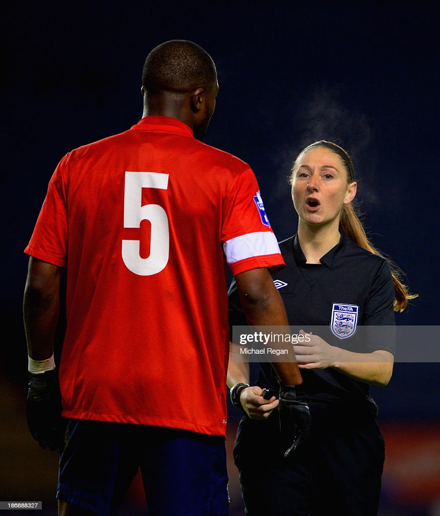 Referee <a gi-track='captionPersonalityLinkClicked' href=/galleries/search?phrase=Sian+Massey&family=editorial&specificpeople=6733765 ng-click='$event.stopPropagation()'>Sian Massey</a> speaks to Yann Songo'o of Blackburn during the Barclays U21 Premier League match between Leicester City U21 and Blackburn Rovers U21 at The King Power Stadium on November 4, 2013 in Leicester, England.